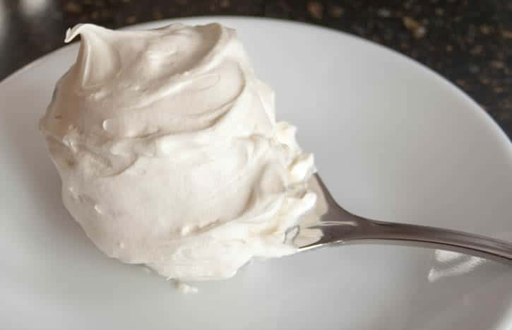 Whipped Cream Cream Cheese Frosting on a Spoon