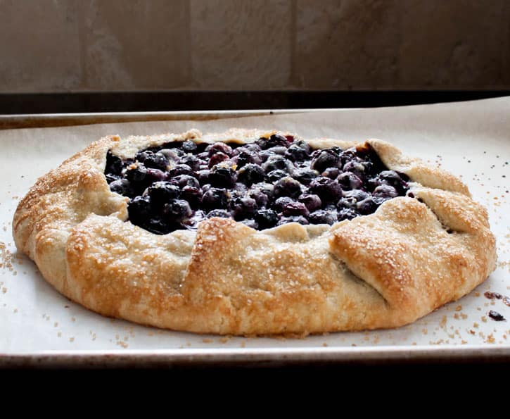 Blueberry Galette fresh out of the oven on a baking tray from themerchantbaker.com