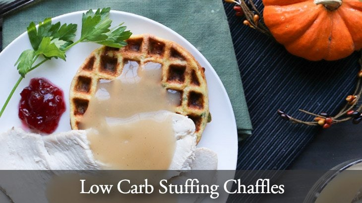 Low Carb Stuffing Chaffles on a white plate with turkey, gravy and cranberry sauce by themerchantbaker.com