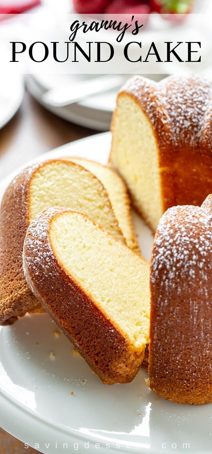 A sliced pound cake topped with powdered sugar
