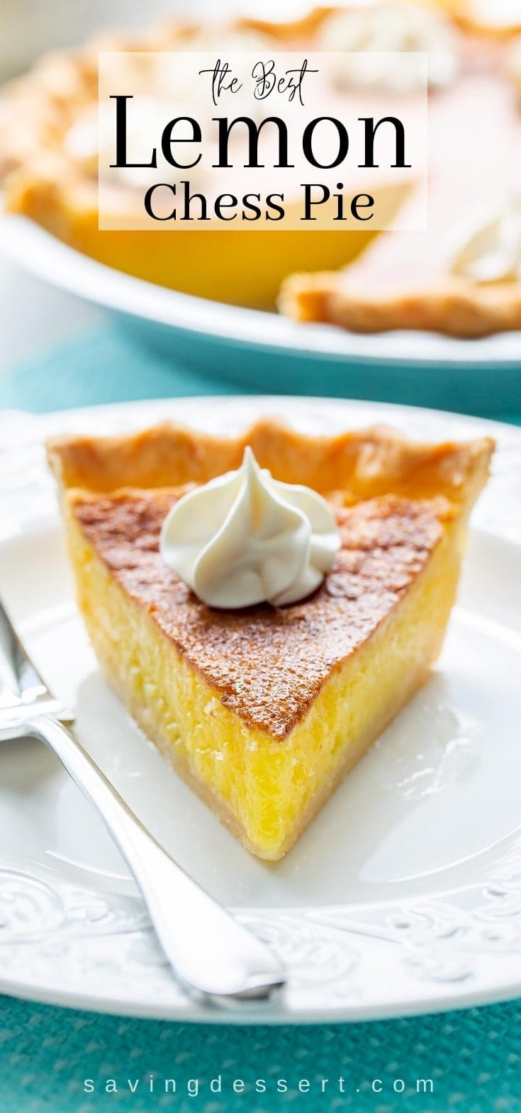 A slice of lemon chess pie on a plate topped with a swirl of whipped cream