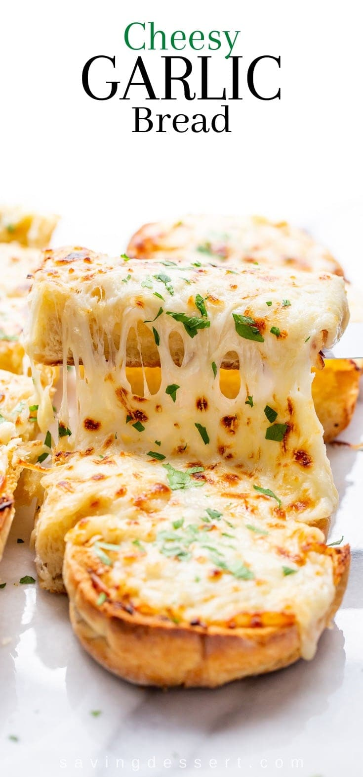 Sliced garlic bread topped with melted cheese and parsley