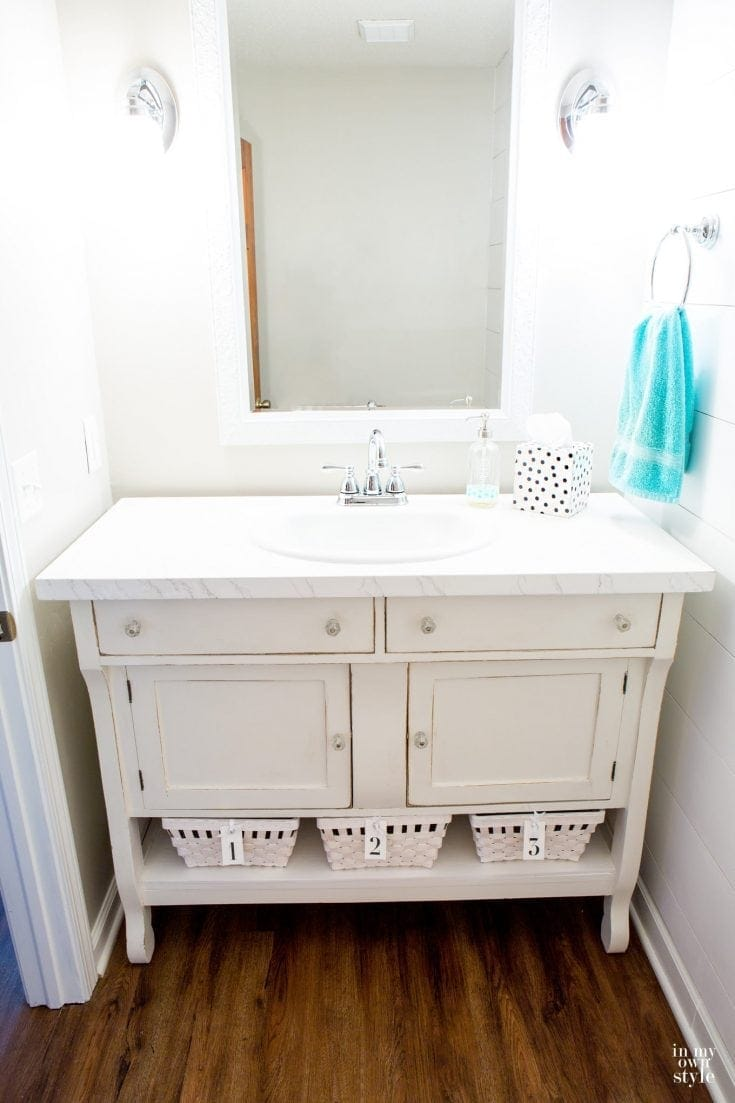 How to make a bathroom sink vanity by repurposing a sideboard or dresser and save yourself hundreds.