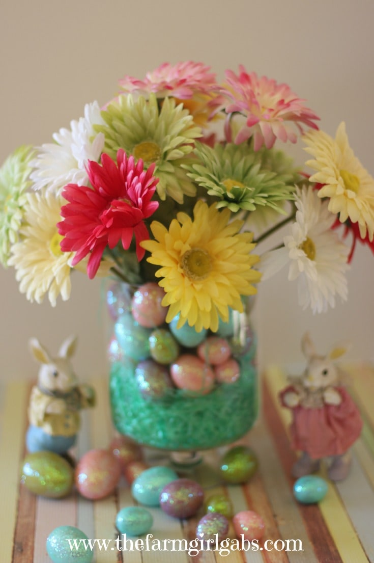 This beautiful spring centerpiece is easy to make and inexpensive too. Learn easy steps to make this colorful spring arrangement. It's perfect for Easter!