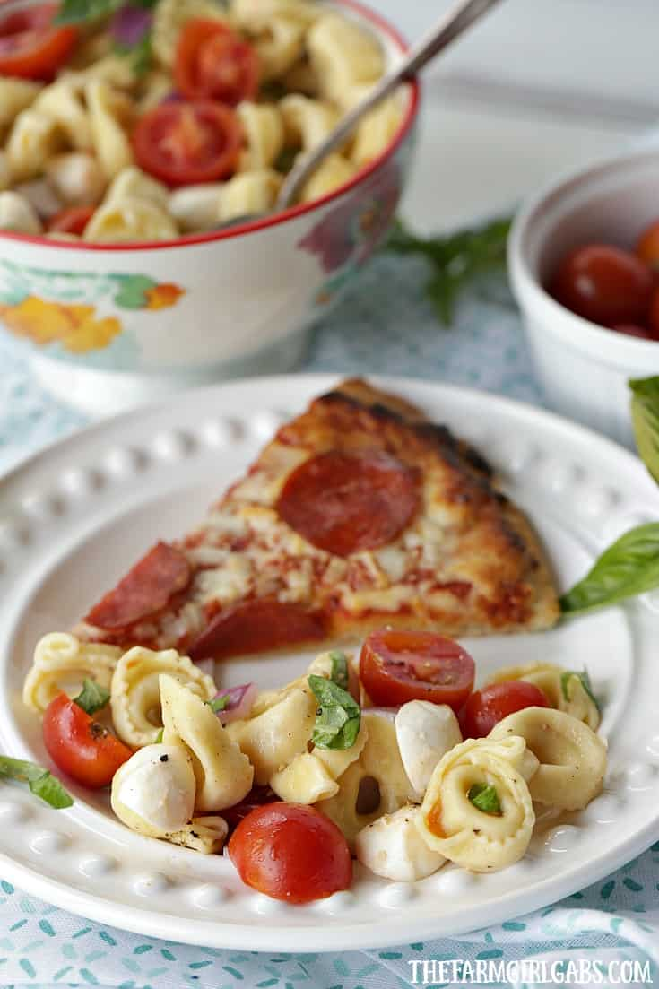 Turn pizza night into party night with this delicious Caprese Tortellini Salad. This recipe is the perfect quick side dish for a weeknight dinner or party.