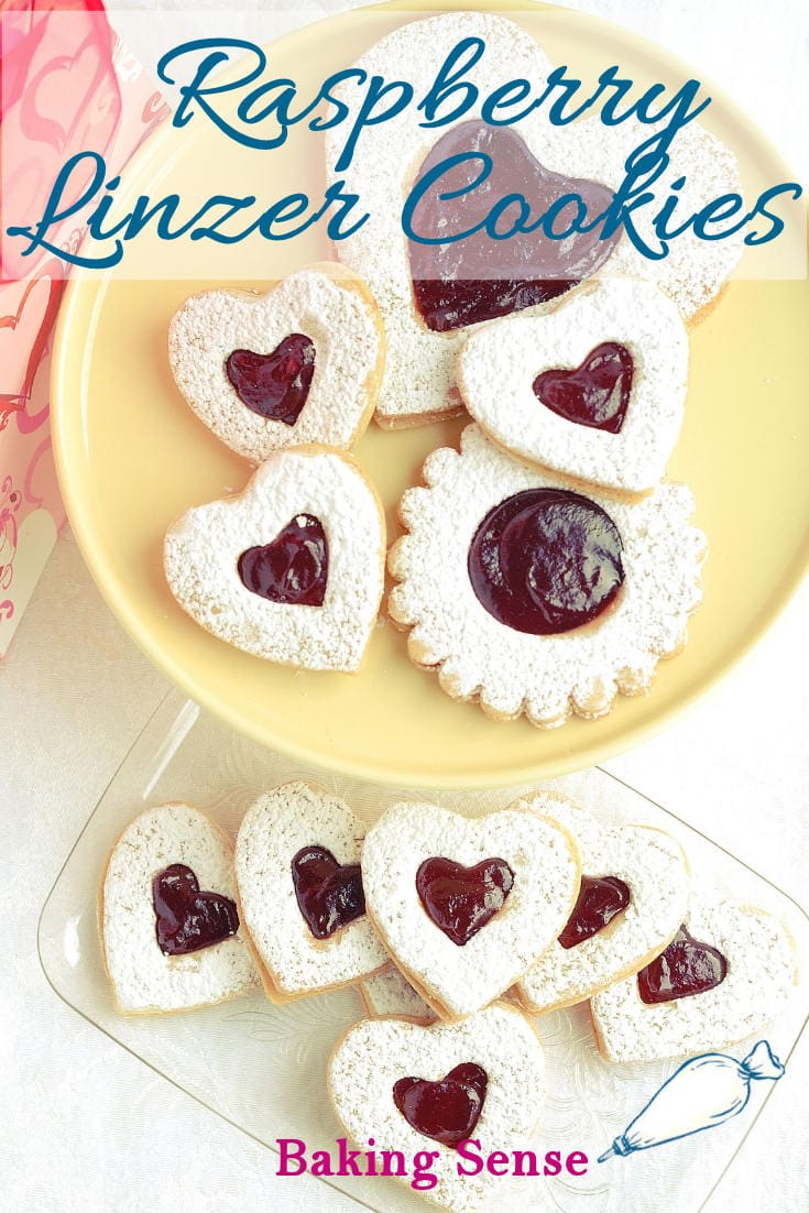 Raspberry Linzer Cookies are the perfect little cookie - Tender almond cookie dough sandwiched with raspberry preserves. Just a hint of rum gives the cookie a special flavor. #linzer  #cookies #raspberry #easy #best #recipe #valentine