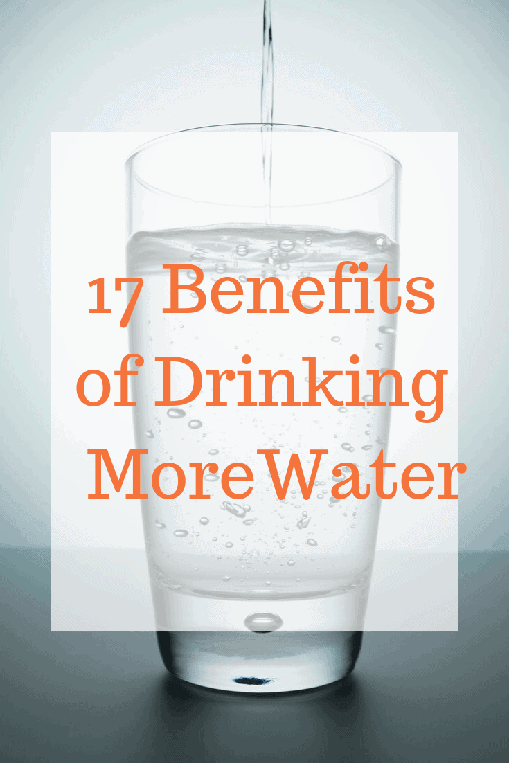 Glass of water with orange text.