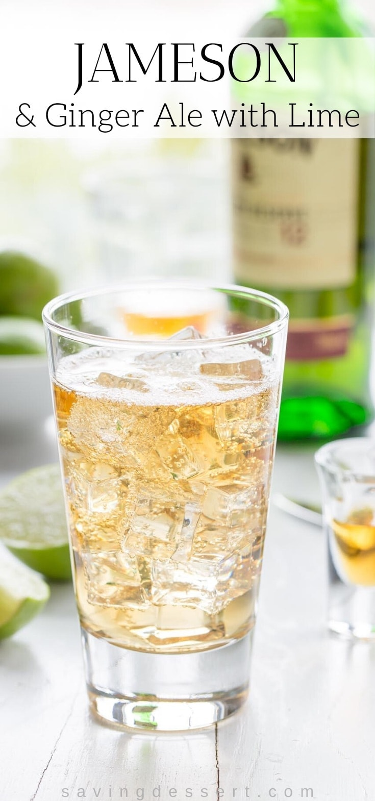 A tall glass with ice, Jameson whiskey and ginger ale with a lime wedge