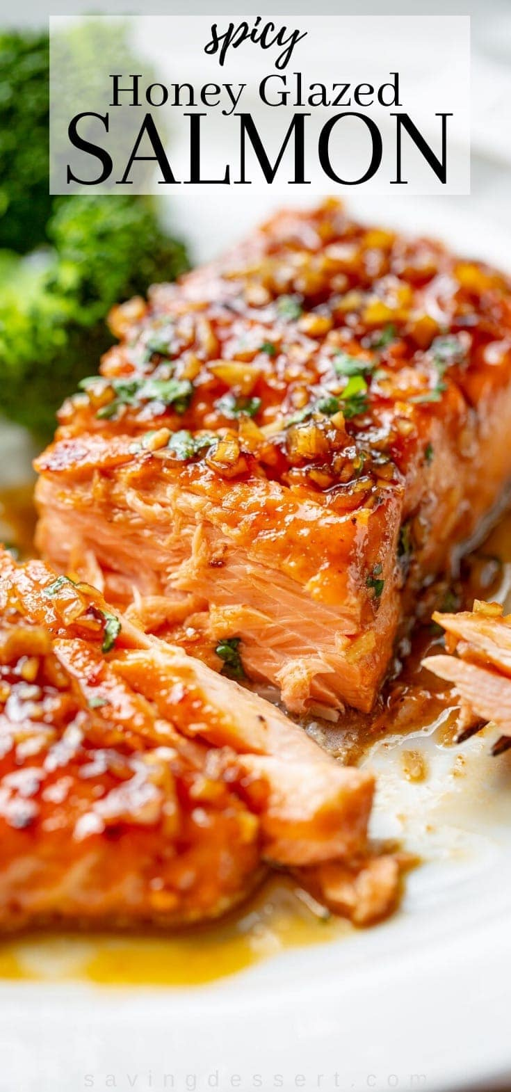 A piece of salmon on a plate with a sticky sweet honey sauce on top
