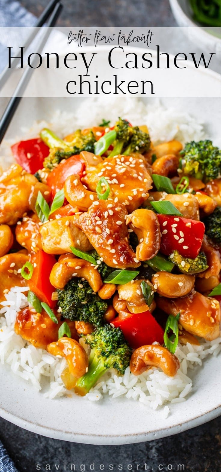 A bowl of rice topped with honey cashew chicken with red peppers and broccoli