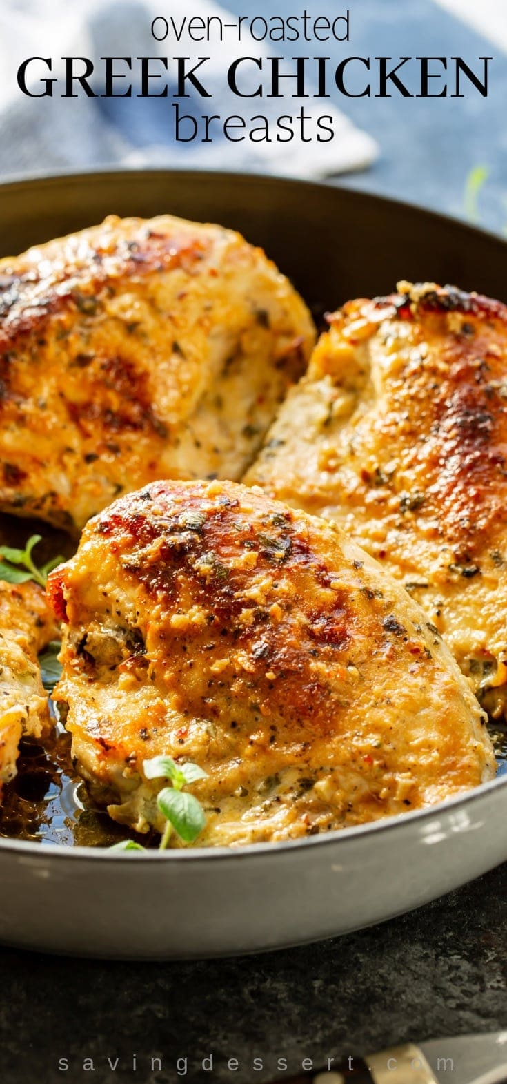 Oven Roasted Greek Chicken Breasts - Enjoy these Mediterranean inspired meaty chicken pieces marinated in an herb and garlic yogurt sauce then slow roasted to juicy perfection! #savingroomfordessert #ovenroastedchicken #Greek #Greekchicken #easydinner #roastedchicken #chickenbreasts #chicken #mediterranean