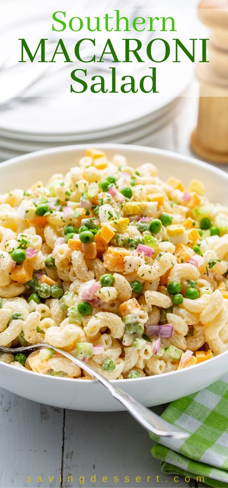 A bowl of macaroni salad with peas and cheese