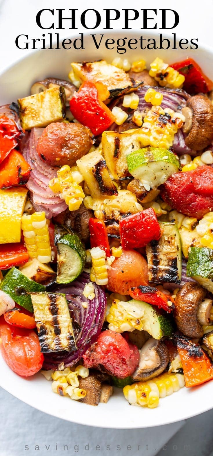 Grilled vegetables in a bowl - corn, squash, eggplant, onion, peppers and tomatoes