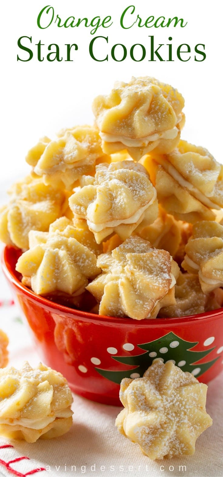 A closeup view of orange cream star cookies in a holiday bowl