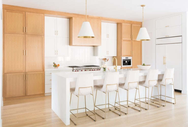 a contemporary kitchen with light oak cabinets and benjamin moore white heron wall paint