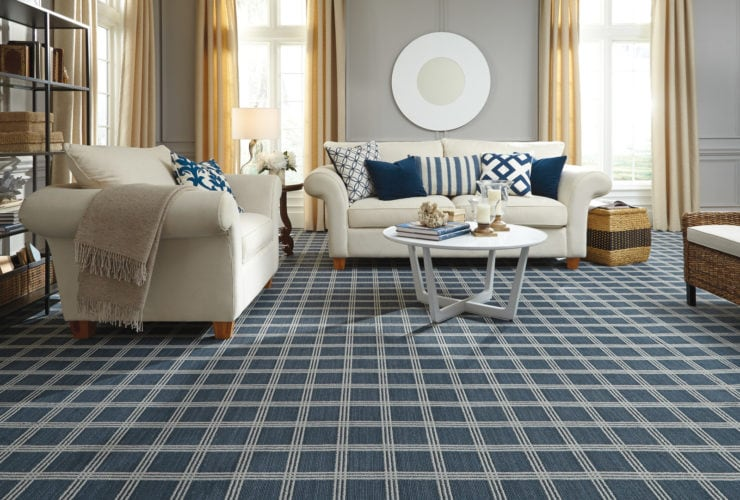 spruce blue square-patterned carpet flooring to match light grey walls in a traditional living room