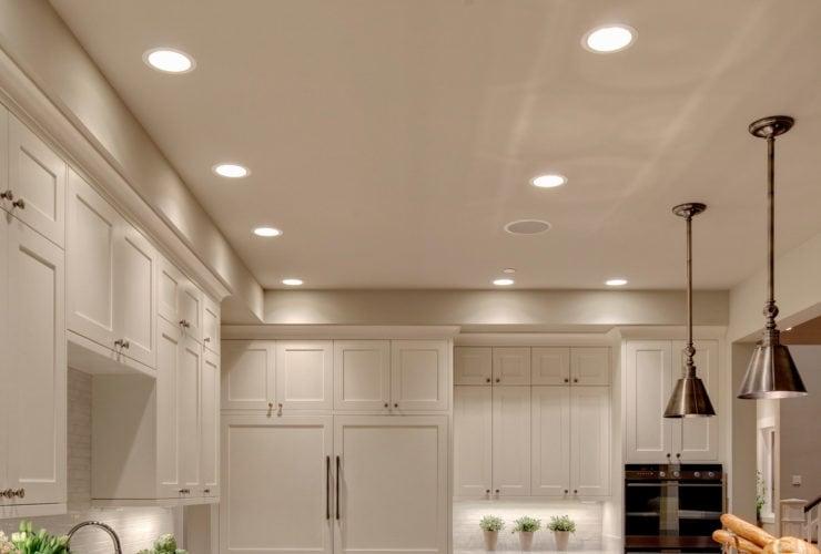 elegant white shaker floor to ceiling cabinets in benjamin moore dove white