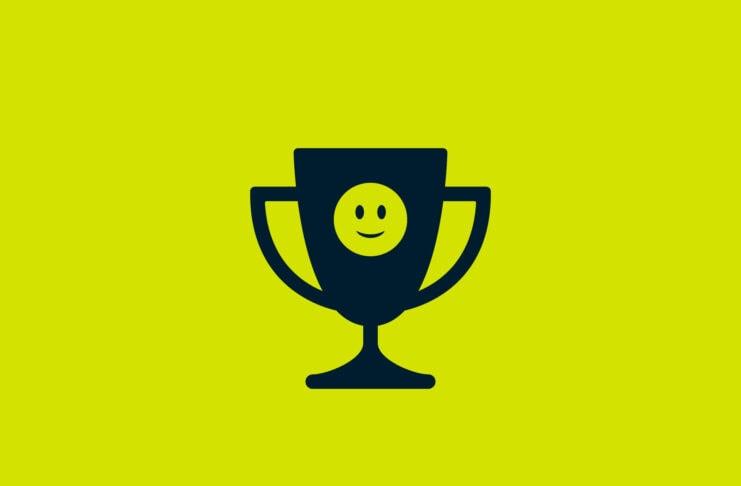 Trophy with slighty smiling emoji on it.