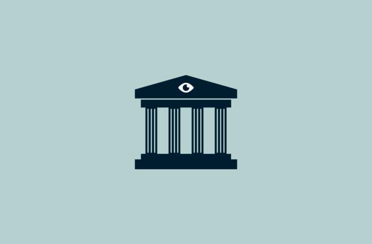 Building facade with columns and an eye.