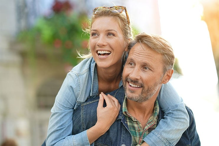 Middle Aged Man And Woman Hugging And Smiling