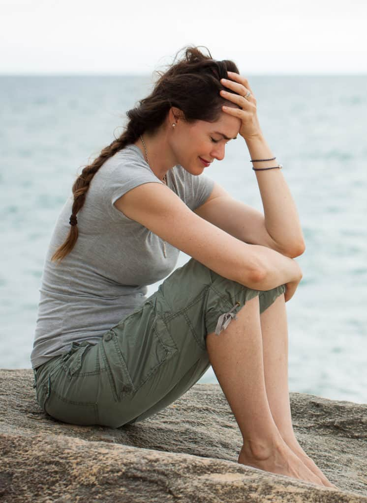 stressed out woman from grief experiencing hair loss