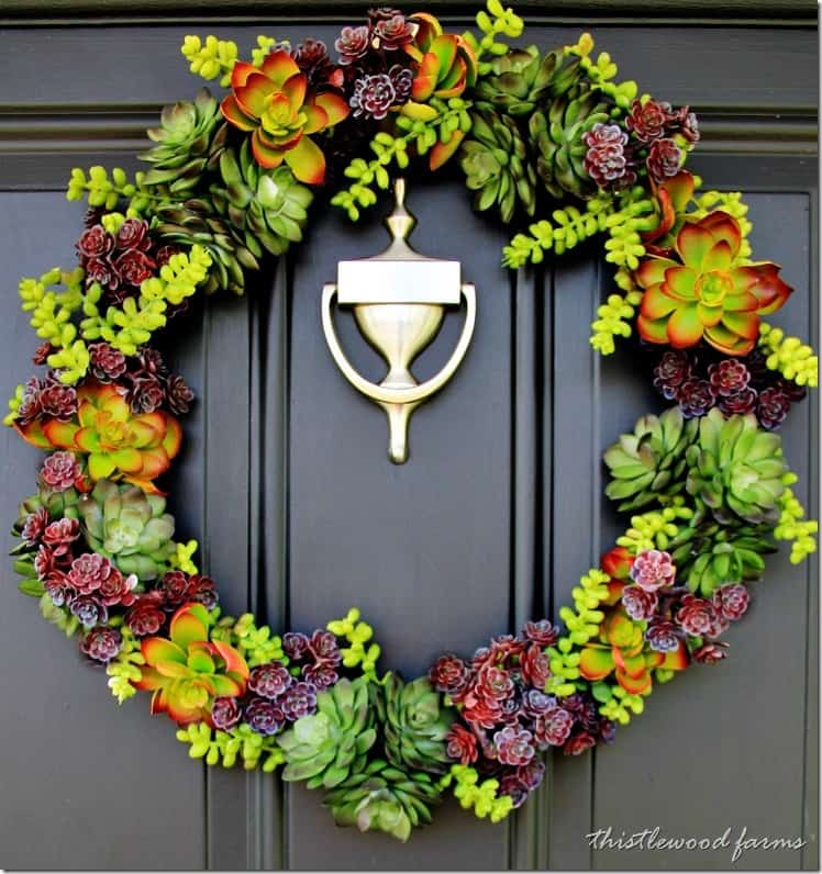 The completed faux succulent wreath on the front door