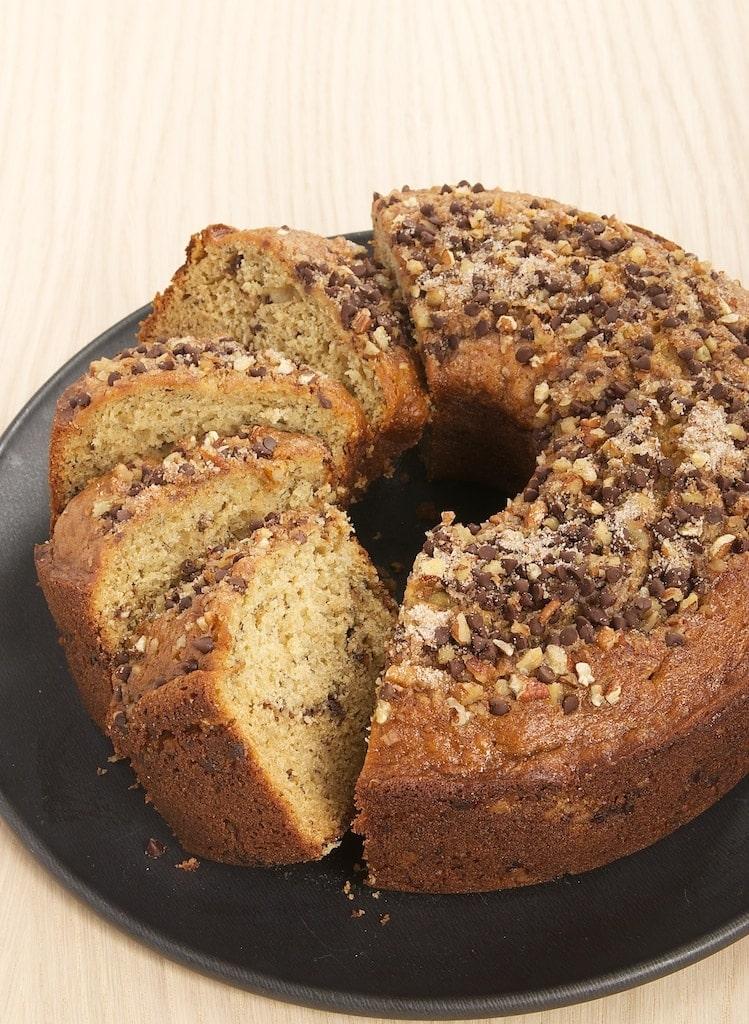Sour Cream Banana Coffee Cake on a dark gray cake plate