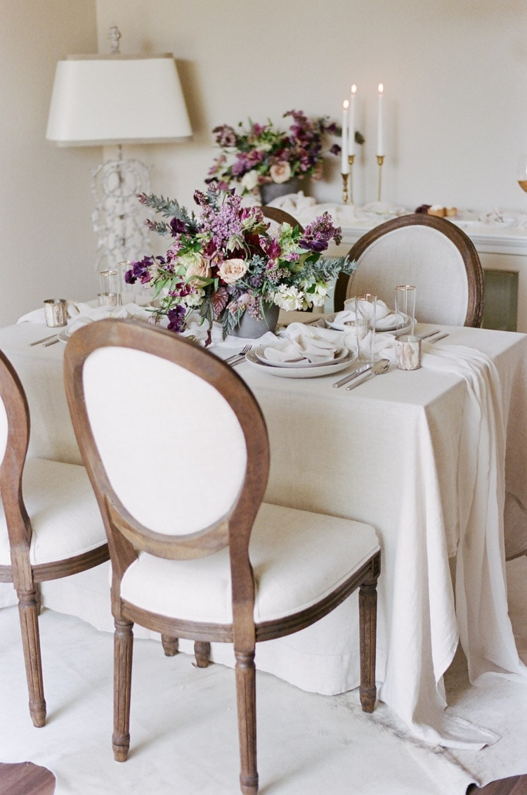 Purple flowers accent a sweetheart table at an intimate elopement in Munich