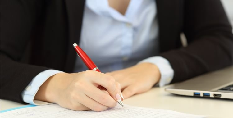 legal assistant filling documents