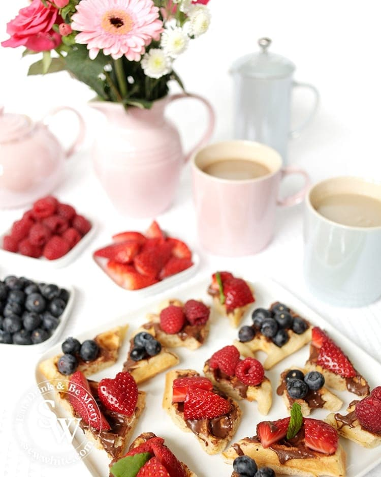 It's a great sweet treat for Afternoon Tea Waffle Bites with nutella and topped with fresh berries.
