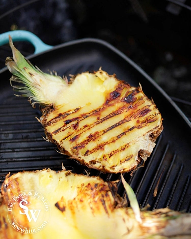 Gold grilled pineapple on the le creuset grill pan in the sunshine.