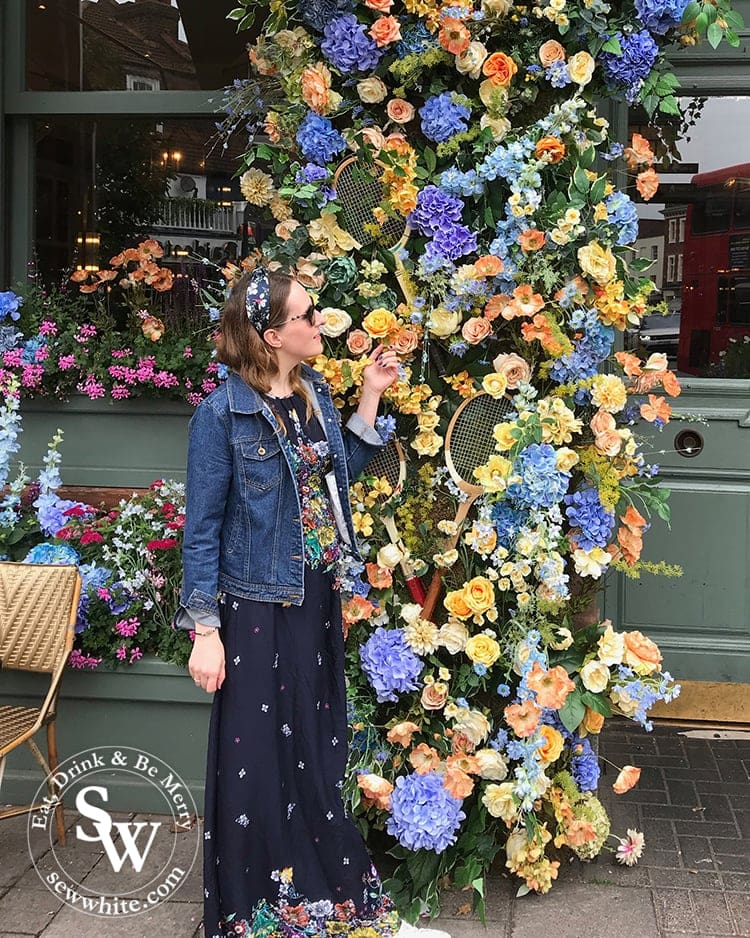 Admiring the flowers at The Ivy Cafe