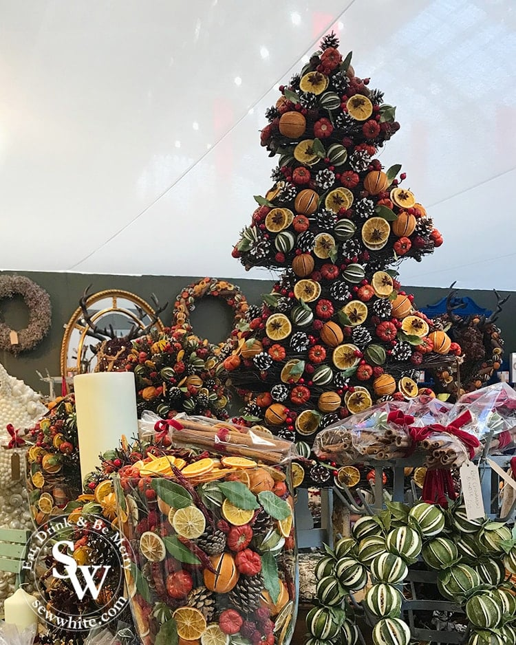 Dried Christmas fruits in the shape of a Christmas tree. Dried oranges and limes and pinecones.