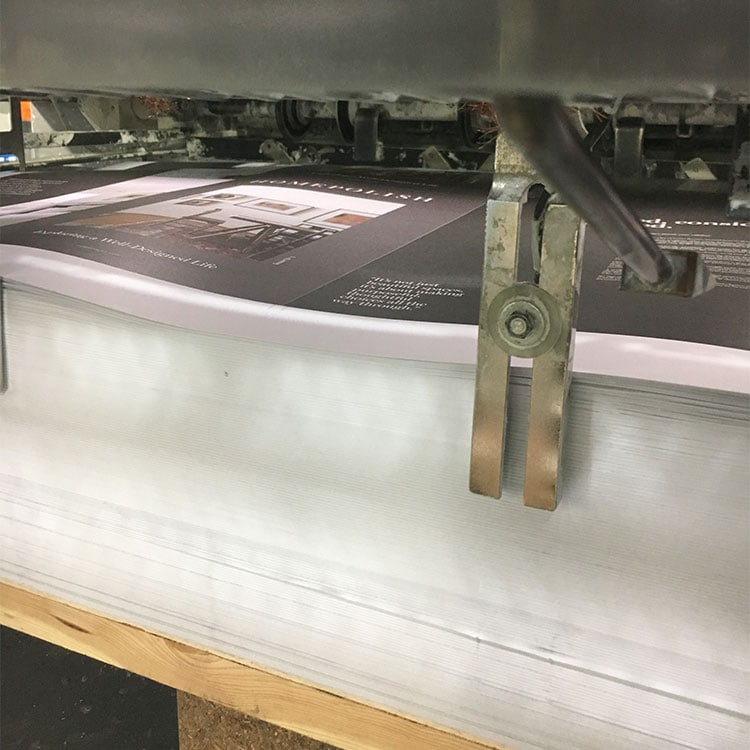 An offset printing job coming off of the press.