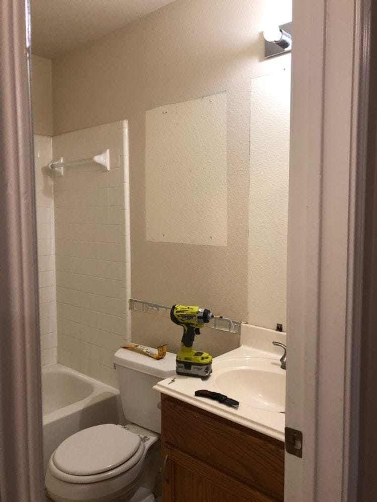 Bathroom With Mirror And Medicine Cabinet Removed For Demo