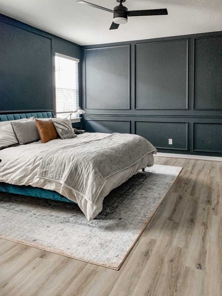 master bedroom with elaborate wall trim