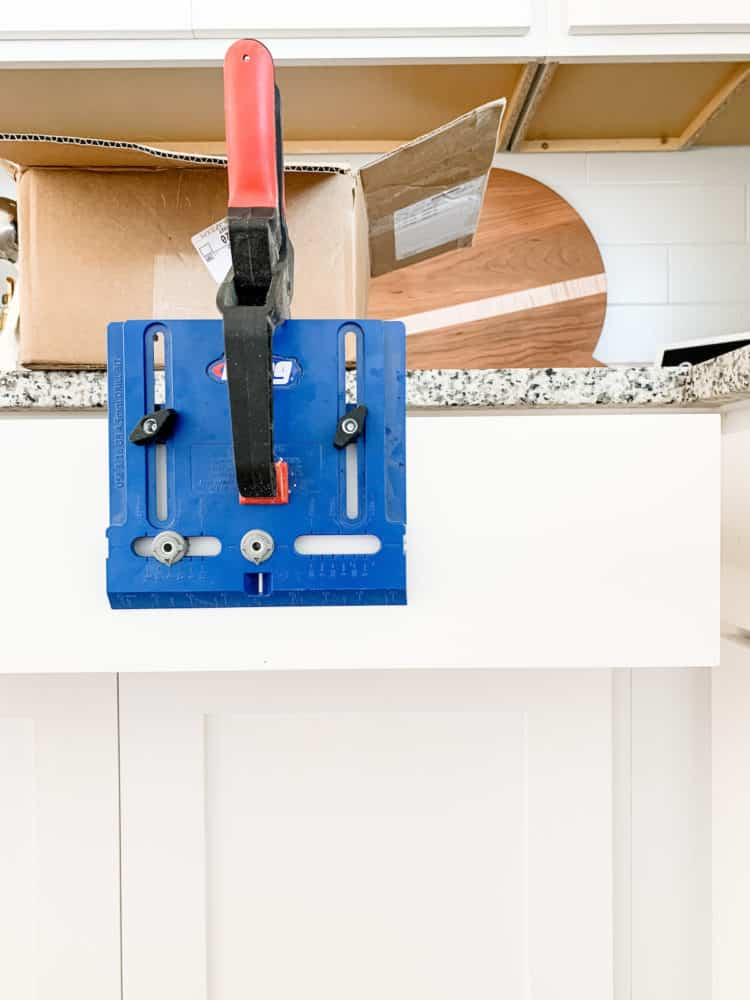 Kreg Cabinet Hardware Jig clamped to a drawer front