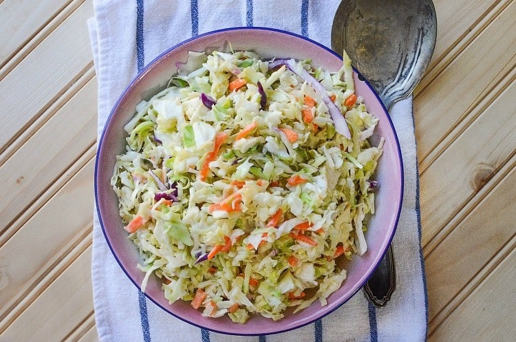 Making homemade coleslaw  saves time and money! Try this quick and easy coleslaw recipe for your next picnic or cookout. It's a homemade coleslaw dressing recipe with the option to use prepackaged coleslaw veggies or shred your own!