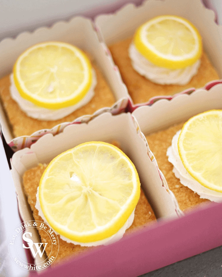 golden brown traybake topped with fresh lemon. Lemon curd centre