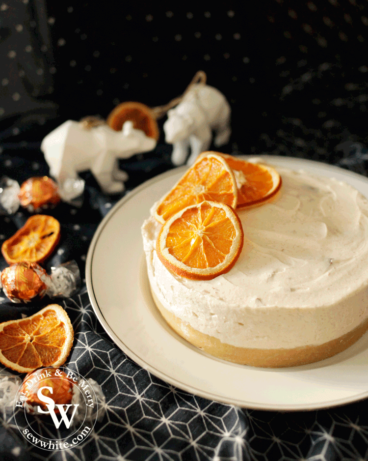 cinnamon and orange cheesecake topped with dried orange slices.