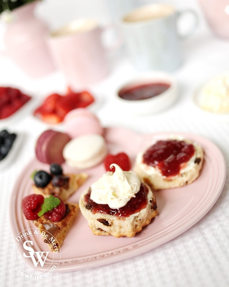 Freshly made scones with clotted cream and jam perfect for mother's day on the heart shaped plate from Le Crueset.