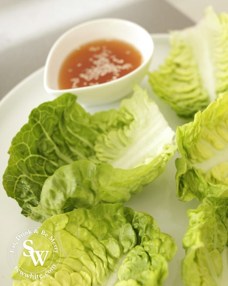 Laying lettuce leaves to make lettuce wraps