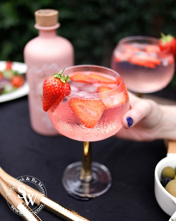 bright pink and red strawberry gin and tonic cocktail in the easy cocktail recipes round up