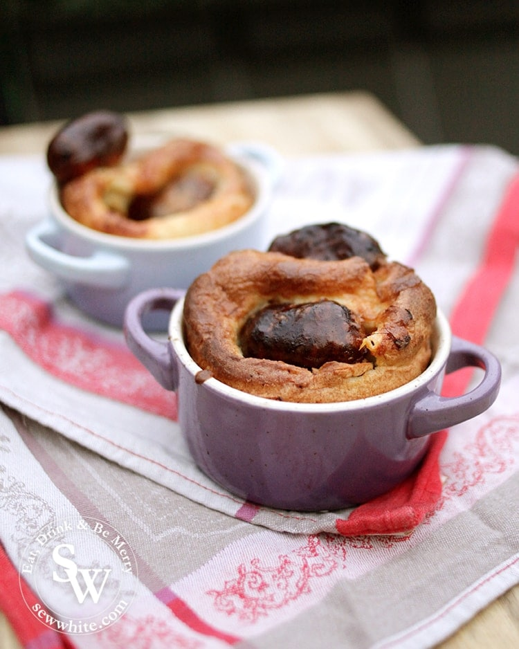 Le creuset mini casseroles in pastel colours filled with my Easy Toad in the Hole. Golden brown batter and dark roasted sausages.