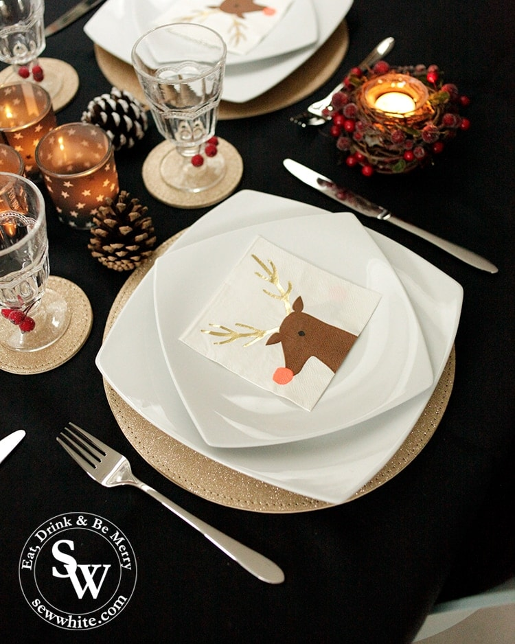 black gold white with red Christmas table setting with Viners Eden set cutlery
