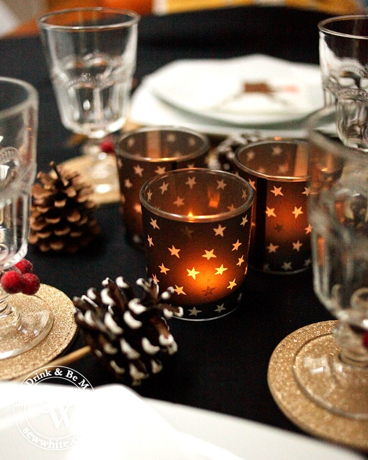 Glowing christmas star candles on the Black Gold and Red Christmas Table