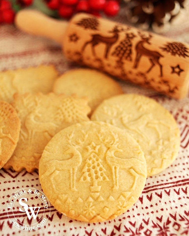 Embossed Rolling Pin Biscuit Recipe showing the finished biscuit with reindeer and Christmas tree