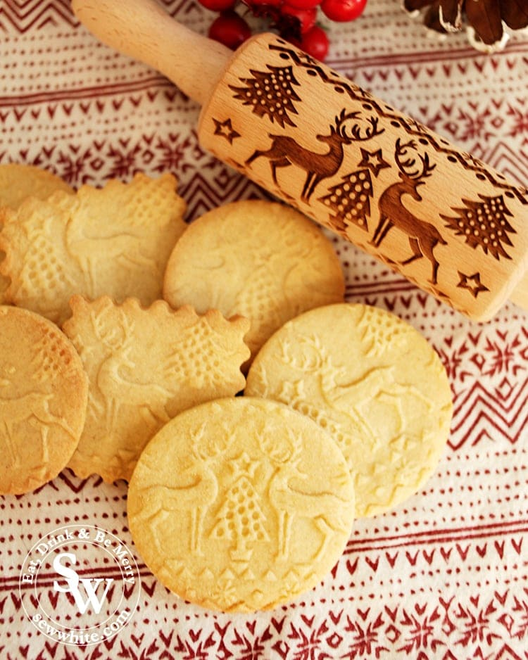 Embossed biscuits fresh out of the oven with reindeer and Christmas trees on