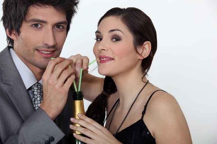 Couple sharing a Champagne bottle