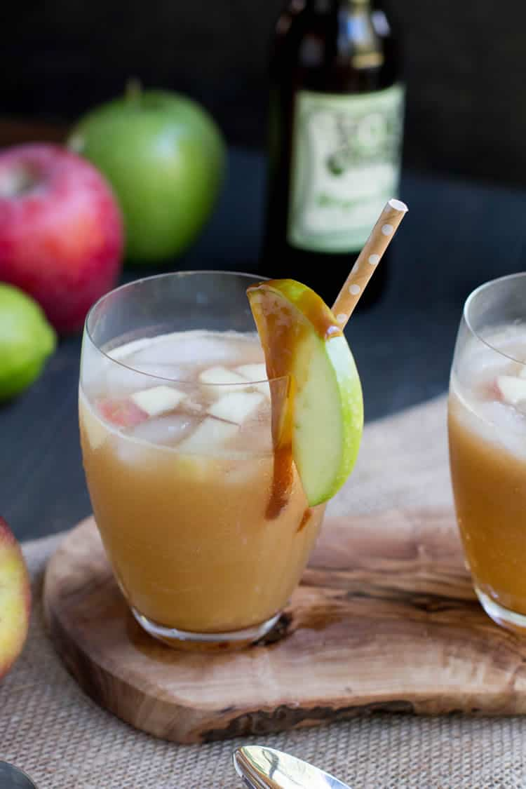 Caramel Apple Cider Cocktail. Apple Cider, caramel sauce, rum and ginger beer come together in this fall inspired cocktail. Perfect for fall gatherings.